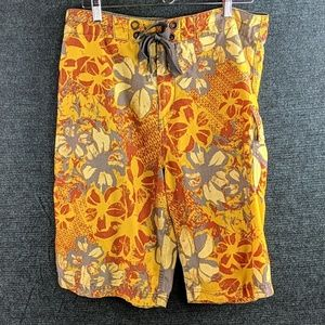 Oakley Floral Print Board Shorts + Oakley Wax Comb